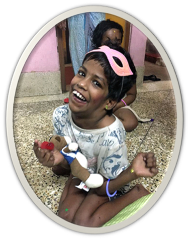 shuktara home for disabled girls - Guria with pink mask laughing