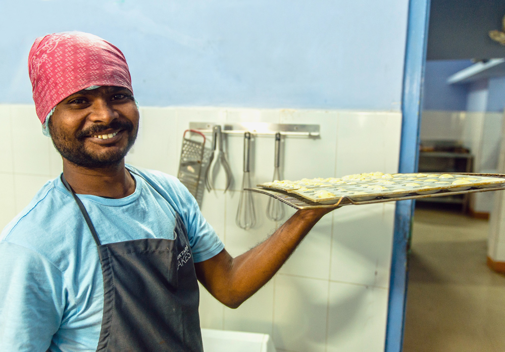Shuktara Cakes - Sanjay with a tray ready for the oven