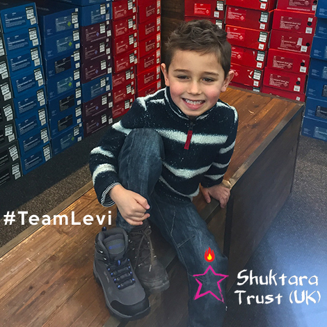 shuktara home for young people with disabilities - Levi looks at walking boots for his walk on Mt Toubkul